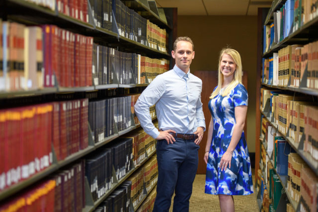 Mitchell Lovett (JD '19) and Demi Allen (JD '19) in the TU Law library
