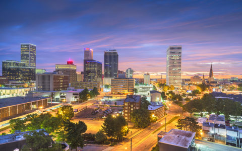 a colorful evening scene of downtown Tulsa buildings